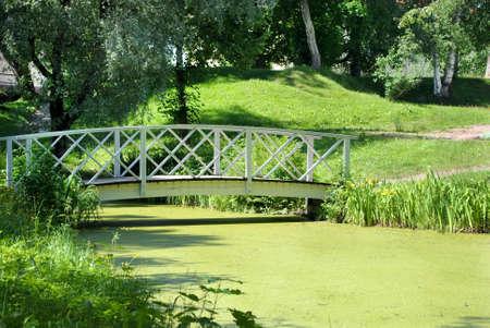 Bridge and pond in the city park  Loviisa in Finland