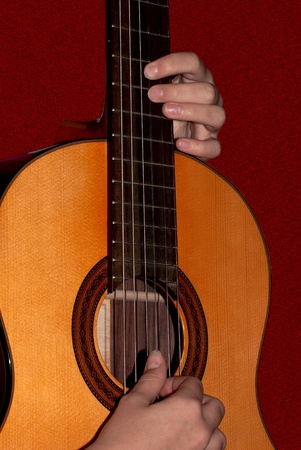 The virtuoso playing the classical six-stringed guitar  Stock Photo