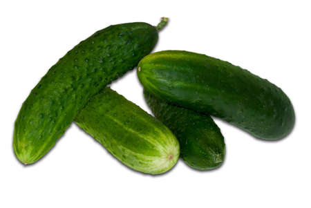 Green cucumbers, isolated on a white background  Stock Photo