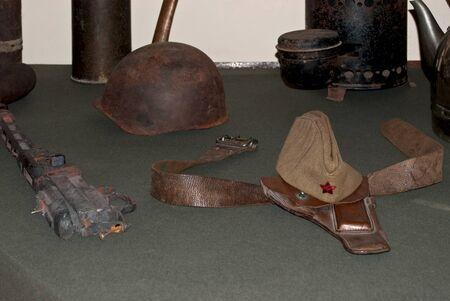 Helmet, cap, belt  Attributes of war  1944  Saint-Petersburg  Stock Photo
