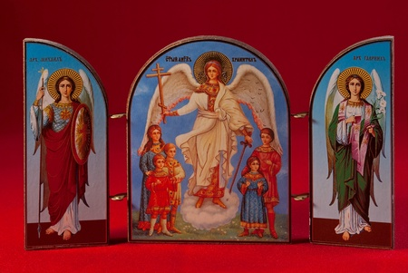 of the holy trinity: Wooden icon with the image of the Holy Trinity isolated on a red background