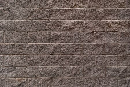 Part of the wall of gray brick
