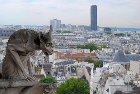 The statue of gargoyles at the top of the Cathedral of Notre Dame