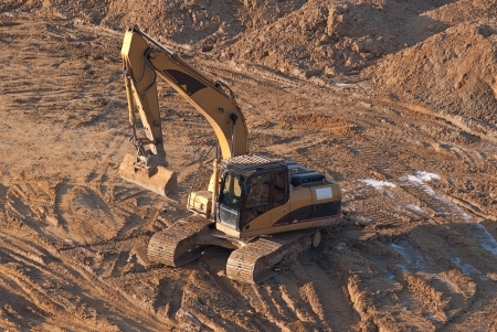 The work of the excavator at a construction site on the Foundation of the building  Stock Photo