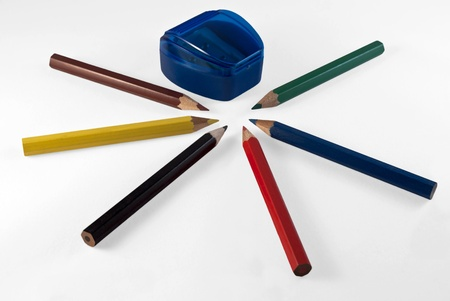The composition of colored pencils arranged in a star  Objects isolated on white background