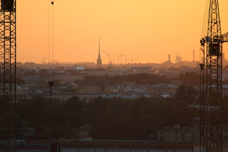 The completion of the construction of the day on the background of sunset in Saint-Petersburg  Stock Photo