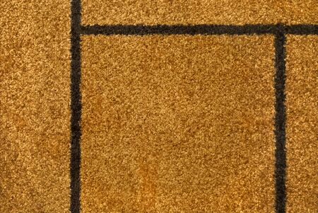 The texture of the yellow carpet pile macro for background and wallpaper