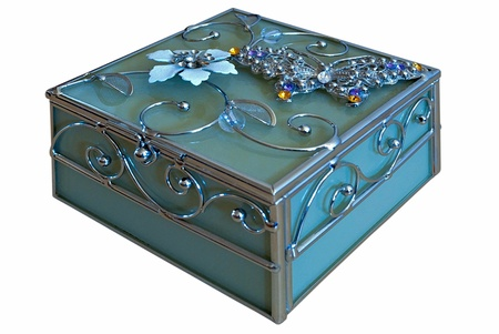 Casket of blue glass with a pattern in the form of a flower, isolated on white background
