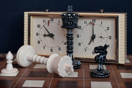Composition with chess and chess clocks  After the game  photo