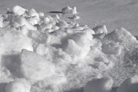 Part of the snow cover, taken close-up, in late spring on a Sunny day