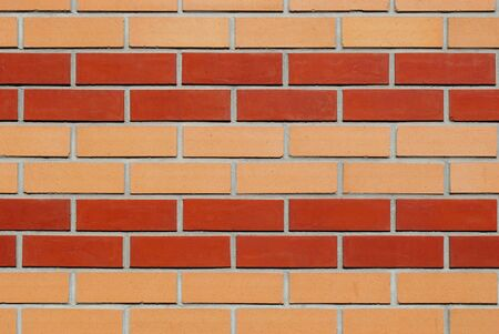 Part of the wall of yellow-red brick