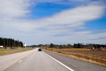 The motorway Helsinki-Lahti on a bright Sunny day