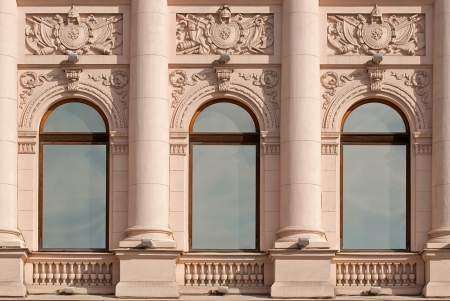 Windows with columns on a beige background wall with bas-relief  From the series window of Saint-Petersburg  Stock Photo