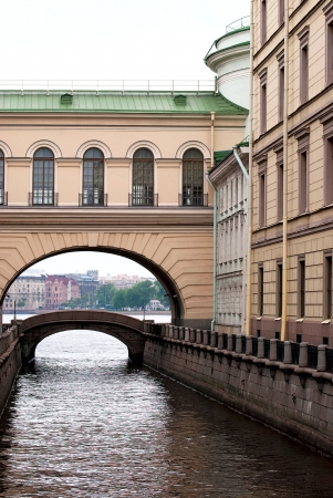 front elevation: View of the house with the arch and the bridge over the canal in Saint-Petersburg