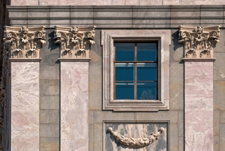 Window with columns on the wall, coated of marble with bas-relief  From the series window of Saint-Petersburg  Stock Photo
