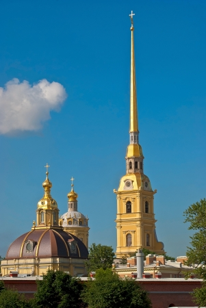 The spire of the main Cathedral and the dome of the Petropavlovskaya fortress background of blue sky  photo