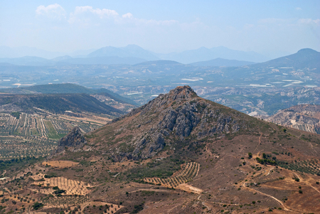 Panoramic view over the mountain on the a sky and clouds with the height of the ancient city of Corinth in Greece