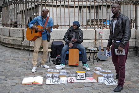 PARIS, FRANCE, June 21  Street Music Ensemble performs his own songs in front of the Sacre Coeur in Montmartre, June 21, 2012 in Paris  Series of other life in Paris