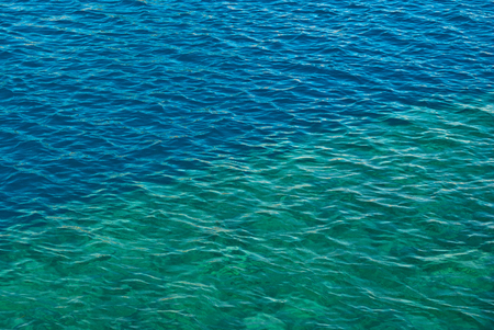 Blue and turquoise sea water surface covered with small ripples waves