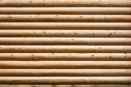 Wall of planed wooden logs. Stock Photo