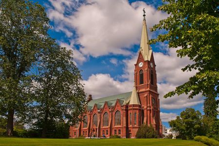 Orthodox church of red brick on blue sky in the Finnish town of Mikkeli. Stock Photo