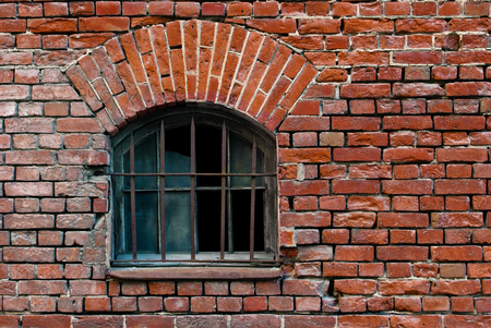 Part of the old wall of red brick with window and arch lattice. From the series window of Saint-Petersburg.