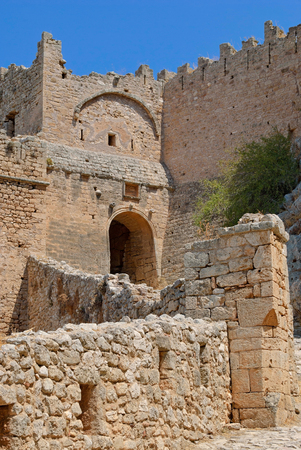The walls and the main entrance to the old fortress of the ancient city of Corinth. Peloponnese, Greece.
