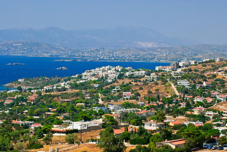 View of the small resort town of Anavissos on the coast of Attica from the height of bird flight. Greece. Stock Photo