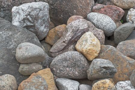 Background of stones of different colors and breeds.