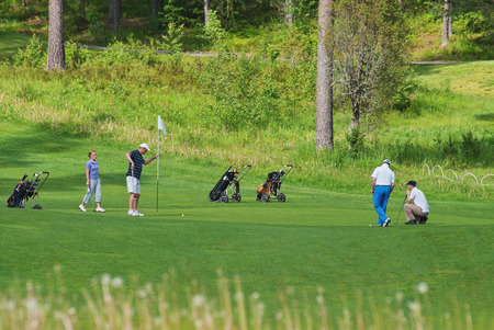 VIERUMAKI, FINLAND, June 23: The Finns are playing golf at one of the many fields in the sports center, golf course - Vierumaki, one of the most favorite places in Finland, recreation and sports, 23 June 2015. Editorial