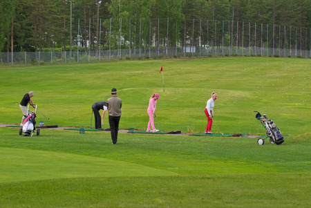 VIERUMAKI, FINLAND, June 23: Golf players to train under the guidance of a coach in a sports center, golf course - Vierumaki, one of the most favorite places in Finland, recreation and sports, 23 June 2015. Editorial