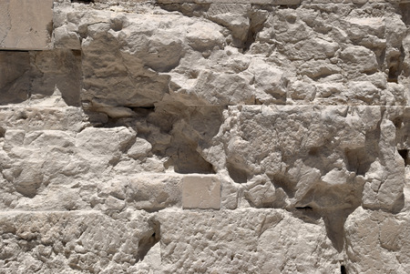 The white walls of limestone marble in the ancient Acropolis of Athens.