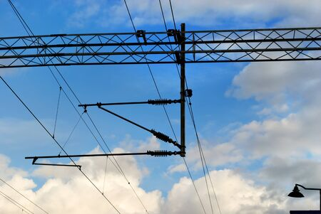 Electric wires for supplying electric power on the electric train on the background blue sky. Stockfoto
