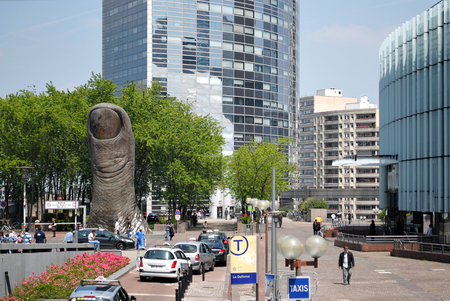 PARIS, FRANCE, June 20: Monument to the finger near the shopping center La Defense. Parisians and visitors relax and shop sunny day June 20, 2012 in the district of La Defense.