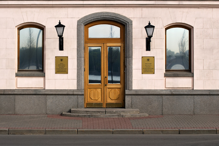building wall: The facade of the building with Windows and the main entrance to the office of the Plenipotentiary representative of the RF President in the northwestern Federal district. Saint-Petersburg. Editorial