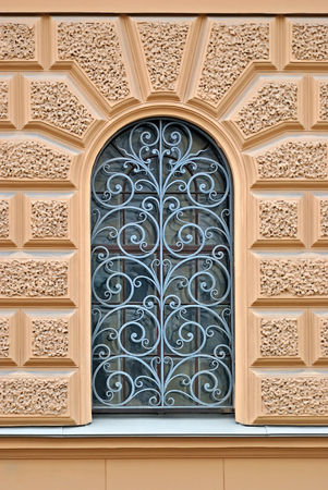 lattice window: Window with arch and decorative lattice on a background of beige wall. From the series window of Saint-Petersburg. Stock Photo