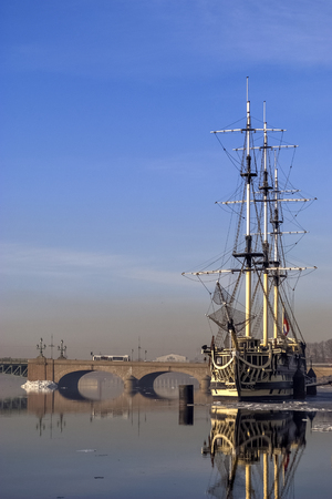 Old sailing ship, equipped with a restaurant on the river Neva in Saint Petersburg in the early spring morning.