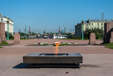 View of a memorial of an eternal flame on the Field of Mars in Saint-Petersburg in spring sunny day.