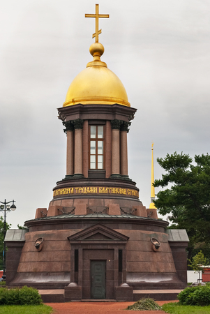 The chapel of pink marble and granite with a gilded dome and cross on the Trinity square on the Petrograd side in Saint-Petersburg. Stock Photo