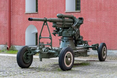 Anti-aircraft artillery gun on a wheeled platform, standing in the courtyard of the Peter and Paul fortress in Saint-Petersburg.