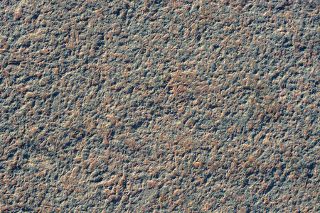 Image fragment of the pavement of gray granite with pink patches for use as a background. Stock Photo