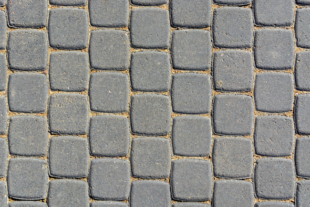 The image of a fragment of the pavement is tiled in grey to use as a background.