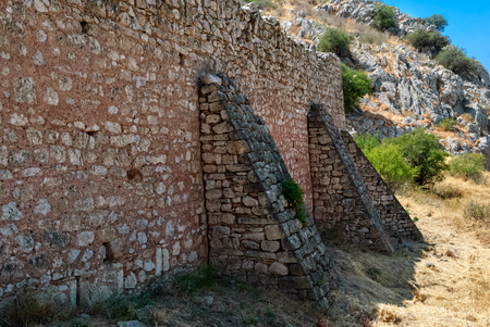 Fragment of the old fortress wall of the ancient Akrocorinth. Peloponnese, Greece.