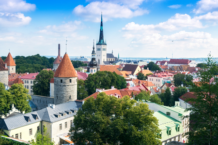 The roofs and towers of the old city of the Estonian capital Tallinn on a bright sunny day. Stock Photo