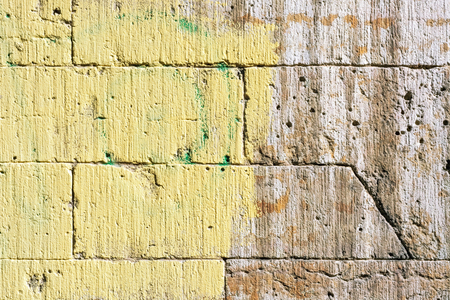 Image of a wall made of brown stone, painted half yellow, for use as a background. 写真素材 - 101526296