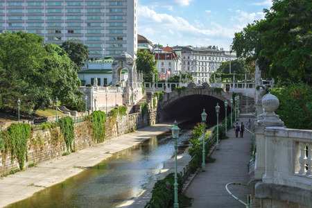 View of the canal embankment in the city park of the city of Vienna - Stadtpark, Austria, on a bright sunny day.