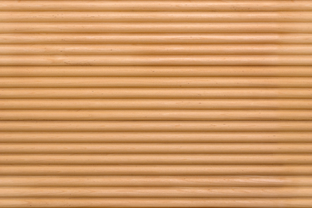 Fragment of a wall of wooden slats for use as a background.