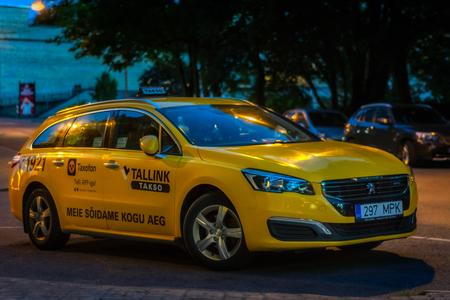 Tallinn, Estonia, August 10: Yellow city taxi late in the evening on old Tallinn, August 10, 2017.