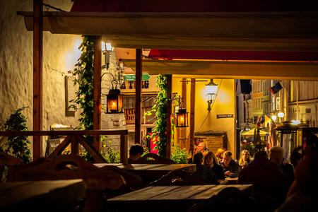 Tallinn, Estonia, August 10: Tourists late at night in one of the restaurants of Old Tallinn, August 10, 2017. Editorial