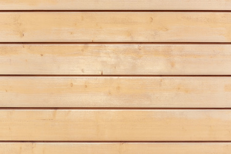 Fragment of a wall of wooden pine planks for use as a background.